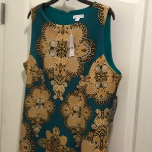 Sleeveless teal and gold pattern dress